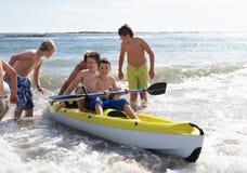 Teenage boys kayaking Royalty Free Stock Photography