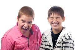 Teenage boys having fun. Teenage boys kidding and joking isolated on white background Royalty Free Stock Photo