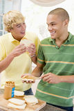 Teenage Boys Making Sandwiches Stock Images