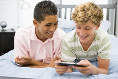 Teenage Boys Playing Video Games.  Royalty Free Stock Images