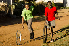 Teenage Boys Playing with Wheel Stock Photo