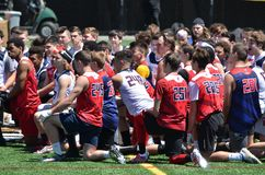 Teenage boys practicing American football. Teenage boys grades 5 through 12 practicing American football and trying to qualify for the next level at USA Football stock images