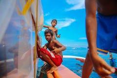 Teenage Boys Sitting on Edge of Boat Royalty Free Stock Images