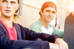 Teenage boys sitting at the street Stock Photo