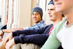 Teenage boys sitting at the street Royalty Free Stock Photography