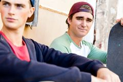 Teenage boys sitting at the street Royalty Free Stock Photos