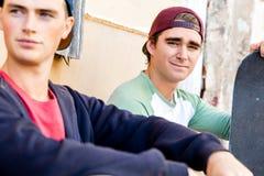 Teenage boys sitting at the street Royalty Free Stock Photo