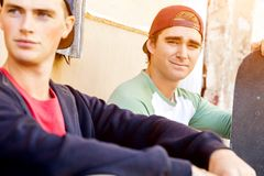 Teenage boys sitting at the street Stock Images