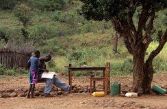 Teenage boys studying outdoors, Mozambique Stock Images