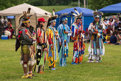 Teenage boys in traditional dress on Aboriginal Da. Teenage boys stand before judges after performing traditional dance in Summer Solstice Aboriginal Arts Royalty Free Stock Photography