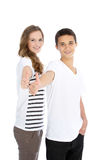 Teenage brother and sister giving a thumbs up Royalty Free Stock Photography