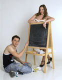 Teenage brother and sister near blackboard Stock Photography