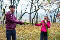 Teenage brother and sister play in an autumn forest royalty free stock photos