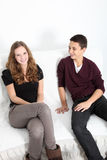 Teenage brother and sister relaxing at home Royalty Free Stock Photo