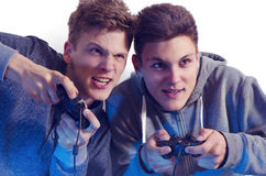 Teenage brothers playing video games funny Stock Images