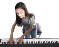 Teenage brunette girl and black upright piano in studio Royalty Free Stock Photography