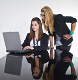 Teenage business girls working on black table Royalty Free Stock Image