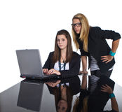 Teenage business girls working on black table Stock Photography
