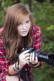 Teenage with camera. Teenage fasion model holding a camera looking forward Stock Images