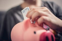 Boy saving money Royalty Free Stock Photography
