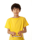 Teenage Chinese Asian boy shuffling cards royalty free stock photography