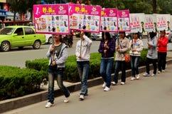 Teenage Chinese Girls with Advertising Placards, Kaifeng, China  Stock Photos