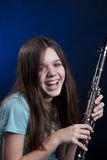 Teenage Clarinet Player On Blue Stock Image
