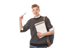 Teenage college boy. Portrait of teenage college boy holding notepad against white background Royalty Free Stock Photo