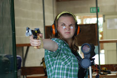 Teenage competitor at shooting range. Teenage girl at shooting range preparing to shoot Stock Photography