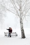 Teenage couple. Having fun at snow in park Stock Images
