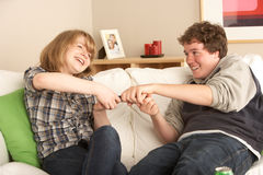 Teenage Couple Arguing Over TV Remote Royalty Free Stock Image