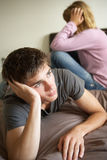 Teenage Couple In Bedroom After Argument Stock Image
