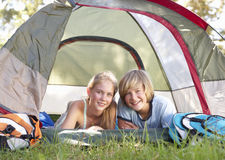 Teenage Couple On Camping Holiday In Countryside Stock Images