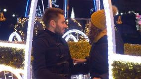 Teenage couple celebrating winter holidays downtown at Christmas market stock footage