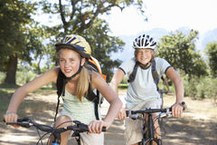 Teenage Couple Cycling Through Countryside Royalty Free Stock Photography