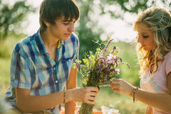 Teenage couple dating on picnic Royalty Free Stock Image