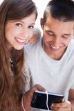 Teenage couple with digital tablet Stock Photography