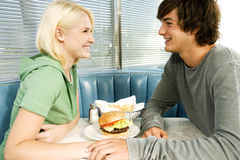 Teenage couple in a diner Royalty Free Stock Photography