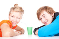 Teenage couple drinking with straws Royalty Free Stock Image