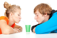Teenage couple drinking with straws Royalty Free Stock Photos