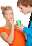 Teenage couple drinking with straws Royalty Free Stock Photography