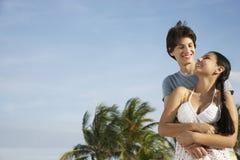 Teenage Couple Embracing On Beach Stock Photography