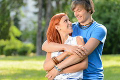 Teenage couple embracing looking at each other Royalty Free Stock Photography