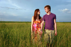 Teenage couple in field Stock Photos