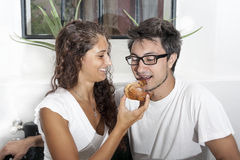 Teenage couple has breakfast at home Stock Images