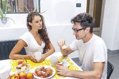 Teenage couple has breakfast at home Stock Photography