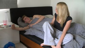 Teenage Couple Having Argument In Bedroom. Teenage girl sitting on end of bed having argument with boyfriend before walking out of room.Shot on Sony FS700 in PAL stock video