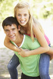 Teenage Couple Having Fun In Park Together Stock Photography