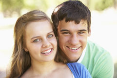 Teenage Couple Having Fun In Park Together Stock Photo