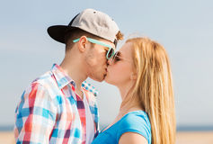 Teenage couple kissing outdoors Stock Images